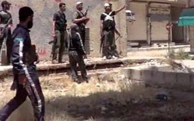 Rebel fighters in Daraa, Syria in May. (photo credit: AP Photo/Ugarit News via AP video)