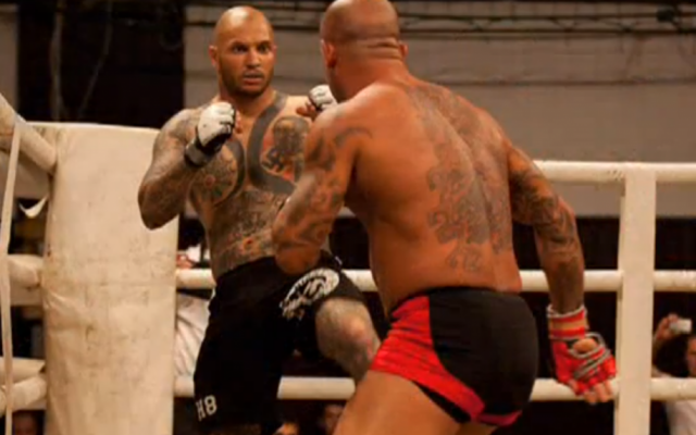 Atilla Petrovszki (left) sporting his anti-Semitic tattoos in a mixed martial arts fight. (photo credit: image capture from YouTube)