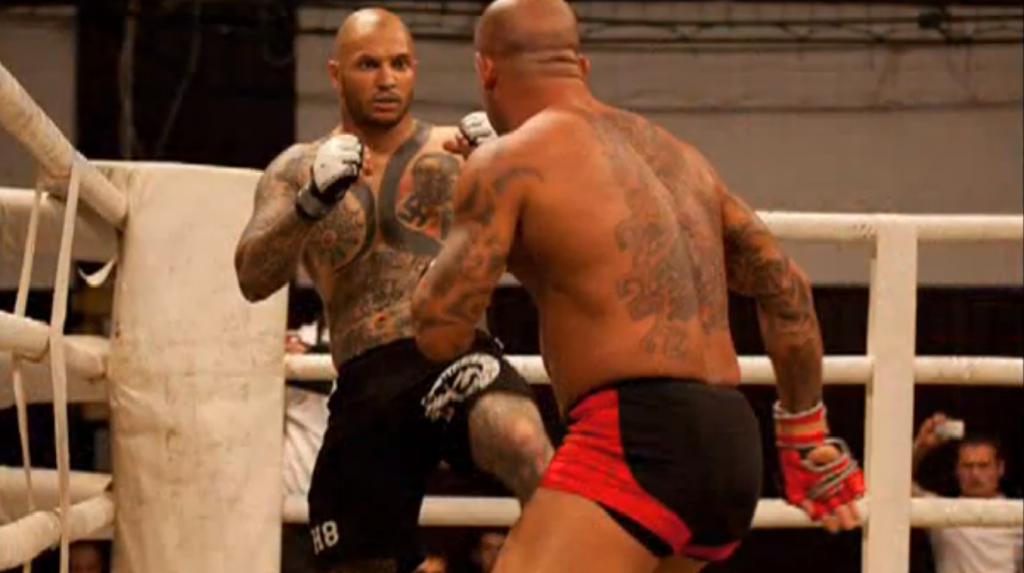 bb7632ae5 Atilla Petrovszki (left) sporting his anti-Semitic tattoos in a mixed  martial arts