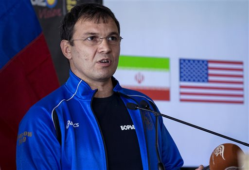 Russia Olympic Wrestling coach Christakis Alexandris addresses other coaches and wrestlers though an interpreter during a news conference at UN headquarters (photo credit: AP Photo/Craig Ruttle)