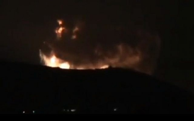 A screenshot from a video purporting to show large explosions on the outskirts of Damascus early Sunday morning. (Screenshot via YouTube)
