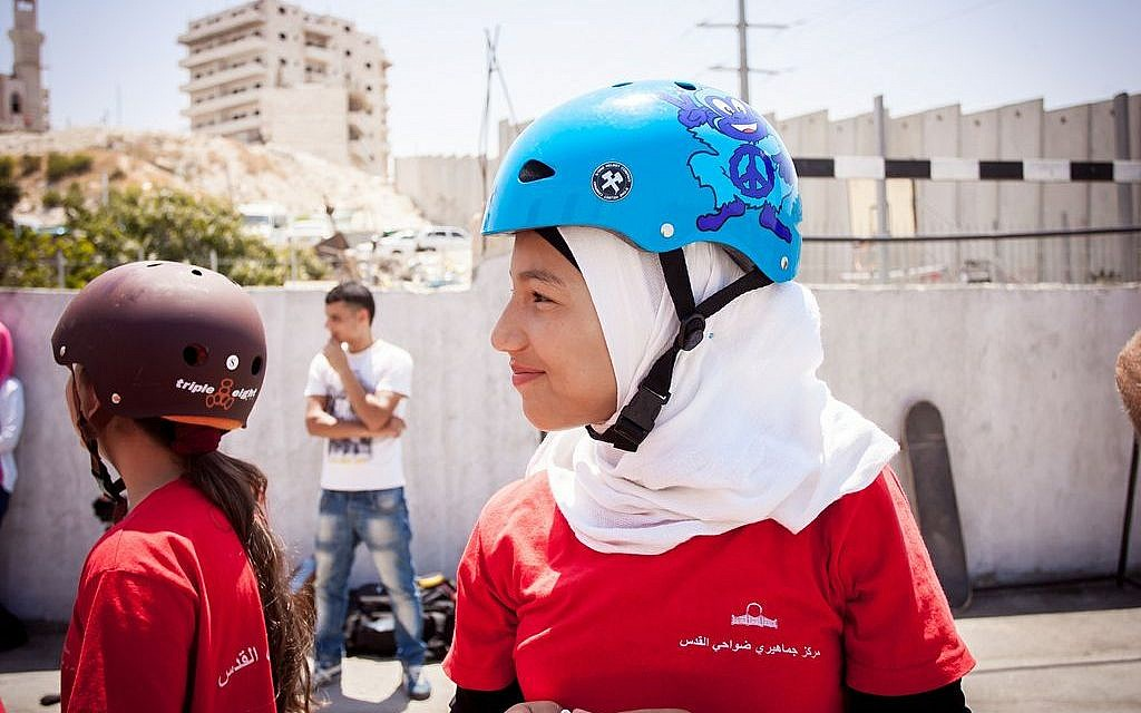 A Palestinian girl smiles at the Longboarding for Peace event at the Shuafat refugee camp last summer (photo credit: Yair Hasidof)