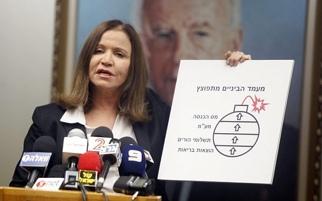Labor Party leader, Shelly Yachimovich, at a press conference, May 5, 2013, appropriating Benjamin Netanyahu's nuclear bomb to highlight the financial plight of Israel's middle classes (photo credit: Flash90)