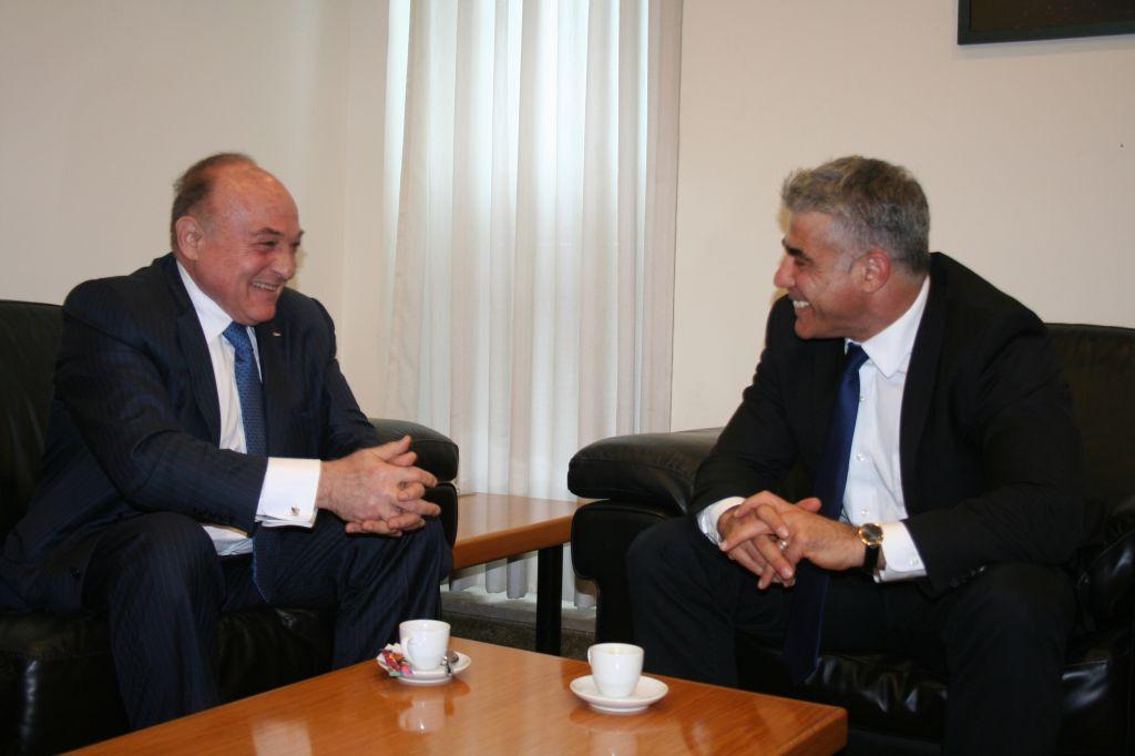 Israeli Finance Minister Yair Lapid, right, with Palestinian counterpart Shukri Bishara in Jerusalem, June 16, 2013 (photo credit: Anat Hamami/Finance Ministry)
