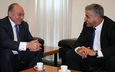 Israeli Finance Minister Yair Lapid, right, with Palestinian counterpart Shukri Bishara in Jerusalem, June 16, 2013 (photo credit: Anat Hamami/Finance Ministry)