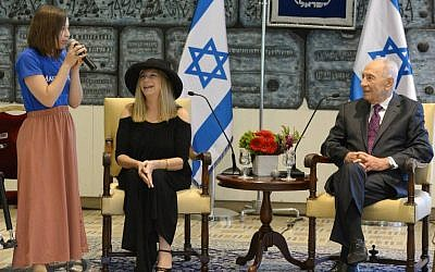 Shimon Peres and Barba Streisand with a girl from the Make-A-Wish Foundation at the President's Residence Monday. (photo credit: Mark Neyman/GPO)