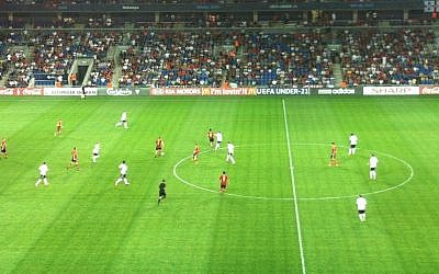Spain (in red) play Germany at the Under-21 Championships, Sunday (photo credit: Aaron Kalman)