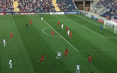 Israel (in white) attack the English goal, Tuesday. (photo credit: Aaron Kalman/Times of Israel)