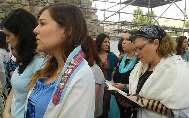 Women of the Wall pray with phylacteries and prayer shawls Sunday morning (photo credit: Ricky Ben-David/Times of Israel)