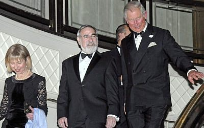 Chief Rabbi Lord Jonathan Sacks escorts Prince Charles at his farewell dinner (photo credit: John Rifkin/courtesy)