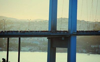 Protesters cross the Bosphorus Strait en masse as they make their way from Taksim Square to Kadikoy to protest the Turkish government's intolerance toward demonstrations, Friday. (photo credit: Facebook)