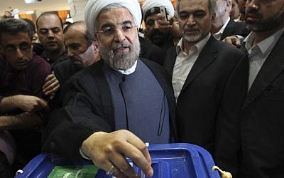 Iranian presidential candidate Hasan Rowhani, a former top nuclear negotiator, casts his ballot during presidential elections at a polling station in downtown Tehran on Friday (photo credit: AP/Vahid Salemi)