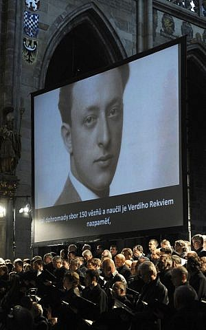 An image of Rafael Schaechter is projected onto a screen during a performance of the Giuseppe Verdi's Requiem Mass at St. Vitus Cathedral in Prague, Czech Republic on Thursday, June 6, 2013. (photo credit: AP Photo/CTK, Stanislav Zbynek)