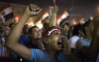 An Egyptian protester chants slogans against Egypt's President Mohammed Morsi during a rally in Tahrir Square in Cairo, Saturday, June 29, 2013 (photo credit: AP/Manu Barbo)