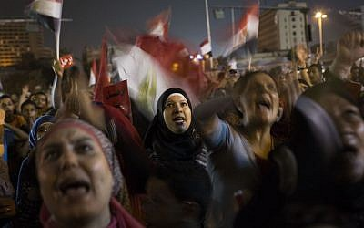 Egyptian women chant slogans against President Mohammed Morsi during a demonstration in in Tahrir Square in Cairo, Thursday, June 27, 2013 (photo credit: AP/Manu Brabo)