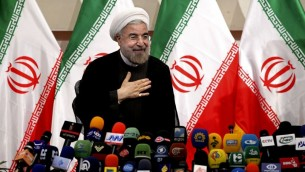 Iran's president Hasan Rouhani at a press conference, in Tehran on June 17, 2013. (photo credit: Ebrahim Noroozi/AP)