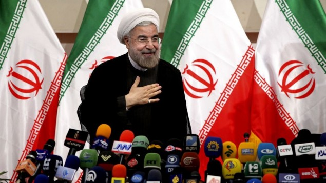 Iran's newly elected president Hasan Rouhani places his hand on his heart as a sign of respect, after speaking at a press conference, in Tehran, Monday, June 17, 2013. (Photo credit:AP/Ebrahim Noroozi)