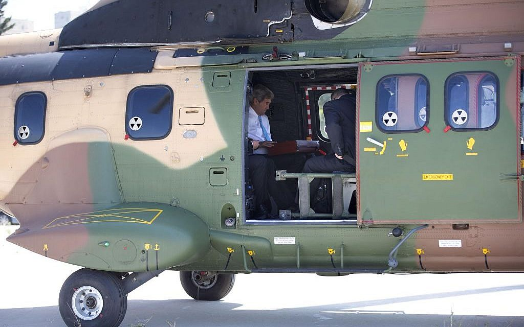 US Secretary of State John Kerry waits for departure after boarding a Jordanian helicopter in Jerusalem, en route to Amman, Jordan, to meet with Palestinian President Mahmoud Abbas, Saturday, June 29, 2013. (photo credit: AP /Jacquelyn Martin)