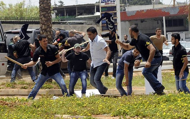 Hezbollah supporters clash with supporters of the Lebanese Option Party during a protest in front of the Iranian Embassy in Beirut, Lebanon, Sunday, June 9, 2013 (photo credit: AP)