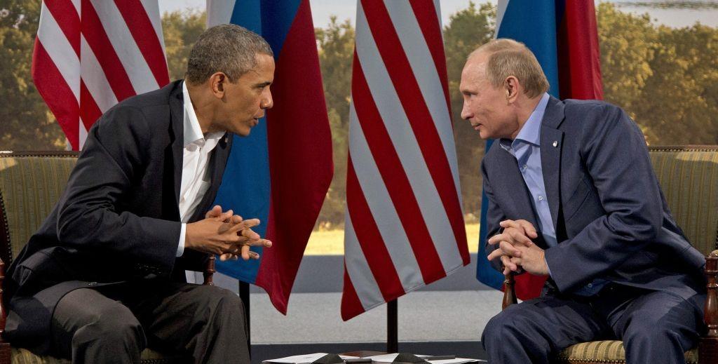 US President Barack Obama, left, and Russian President Vladimir Putin in Enniskillen, Northern Ireland, June 17, 2013 (photo credit: AP/Evan Vucci)