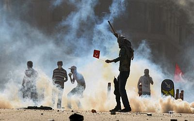 Riot police clashing with protesters in Istanbul on Saturday (photo credit: AP)