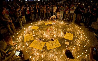 Turks light candles for the victims of the protests at Taksim square, in Istanbul, early Saturday, June 15, 2013. (AP Photo/Vadim Ghirda)
