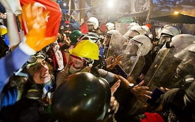 Protesters try to resist the advance of riot police in Gezi park in Istanbul, Turkey, Saturday, June 15, 2013. (Photo credit: AP/Vadim Ghirda)