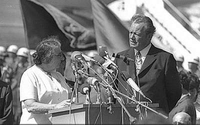 Prime minister Golda Meir welcoming West German chancellor Willy Brandt at the Lod airport, on June 7, 1973. (photo credit: Moshe Milner, GPO)