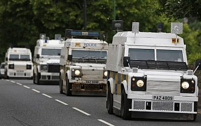 Police trucks patrol the streets around the G8 summit venue in Enniskillen, Northern Ireland on Sunday, June 16 (photo credit: AP/Lefteris Pitarakis)