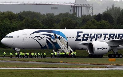 Passengers leave the Egyptair aircraft at Prestwick Airport, Scotland, after it was diverted while en route from Cairo to New York on Saturday. (photo credit: AP/Andrew Milligan /PA)