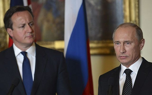 British Prime Minister David Cameron, left, stands with Russian President Vladimir Putin during a press conference at 10 Downing Street in London, on Sunday June 16, 2013. (photo credit: AP Photo/Anthony Devlin)