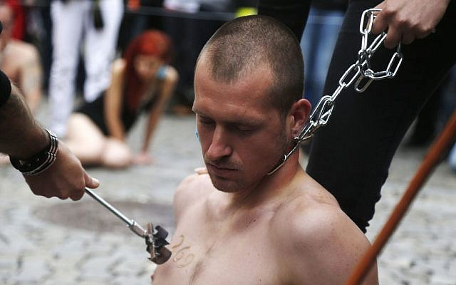 Animal rights activist is branded with number 269 in Prague, Czech Republic, Wednesday, June 26, 2013 (photo credit: AP/Petr David Josek)