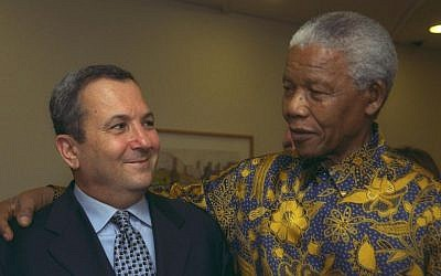 Then-prime minister Ehud Barak, left, with Nelson Mandela in the Prime Minister's Office in Jerusalem, October 19, 1999. (photo credit: Avi Ohayon/GPO)
