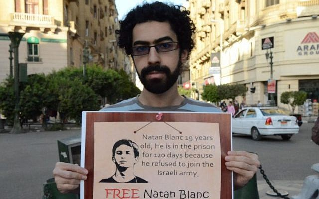Egyptian pacifist Emad Al-Dafrawi poses with a sign in support of Nathan Blanc, Cairo, April 19 (photo credit: courtesy/Nader Wagdy)