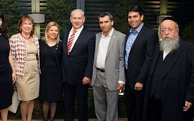 Prime Minister Benjamin Netanyahu with Deputy Defense Minister Danny Danon (second from right) and Deputy Foreign Minister Ze'ev Elkin (third from right) at a Rosh Hashana celebration in 2011. (Photo credit: Itzik Biran/Flash90)