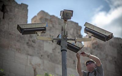 A technician fixes security cameras located near Jerusalem's Old City (photo credit: Noam Moskowitz/Flash90)