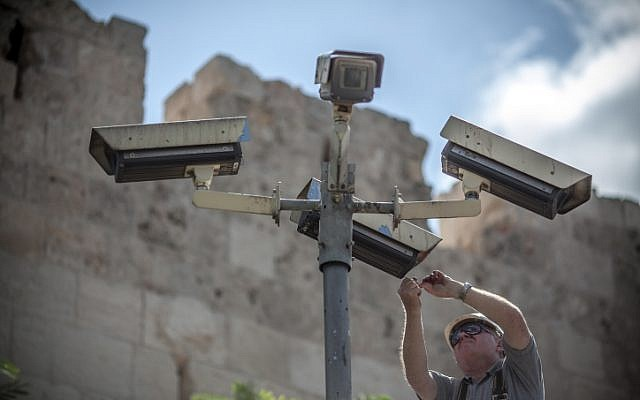 A technician fixes security cameras located near Jerusalem's Old City (photo credit: Noam Moskowitz/Flash90)
