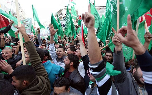 Palestinian supporters of Hamas attend a rally marking the 25th anniversary of the Islamist movement's foundation in the West bank town of Ramallah, December 14, 2012 (photo credit: Issam Rimawi/Flash90)