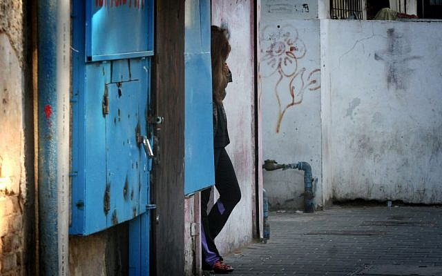 A sex worker in Tel Aviv. The State Department's 2013 report on Trafficking in Persons found that Israel led a 'sustained strong law enforcement actions against sex and labor trafficking.' (photo credit: Flash90)