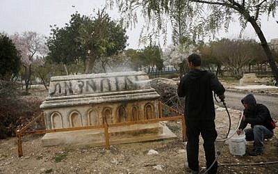The graffiti on this grave in a Muslim cemetery in Jerusalem reads 'Muhammad is dead' (Photo credit: Miriam Alster, Flash 90)