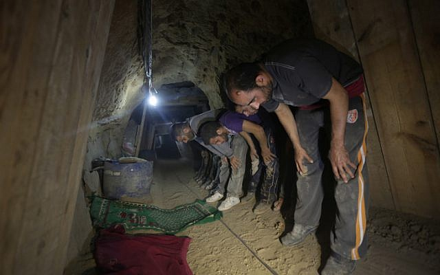 Tunnel workers taking time off to pray on the Gaza side of Rafah (photo credit: Wissam Nassar/Flash90)