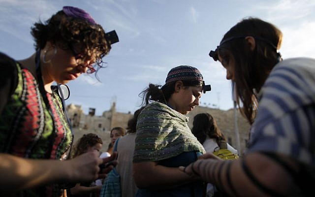 Women of the Wall members pray while wearing traditional prayer shawls and tefillin, May 2013. (photo credit: Flash90)
