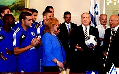 Prime Minister Benjamin Netanyahu meets with the Israel under-21 soccer team ahead of this week's European Championship. (Photo credit: Moshe Milner/ GPO/Flash 90.)