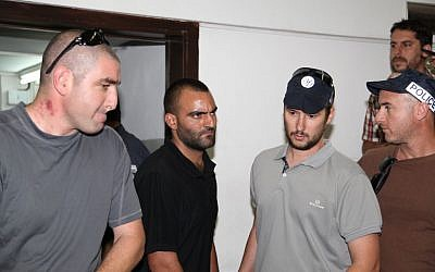 Hagai Felician (second from left), the prime suspect in the 2009 gay youth club shooting, at the Tel Aviv magistrate's court, on Thursday, June 6, 2013
