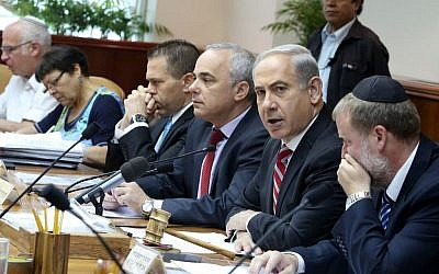 Prime Minister Benjamin Netanyahu, second from left, leads the weekly cabinet meeting on June 9, 2013. (photo credit: Marc Israel Sellem/Flash90)