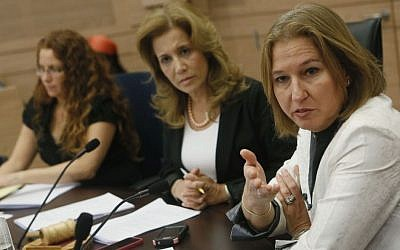 MK Aliza Lavie of Yesh Atid (center) with Minister of Justice Tzipi Livni (right) at a Committee for the Status of Women meeting in the Knesset, June 10, 2013. (photo credit: Miriam Alster/Flash90)