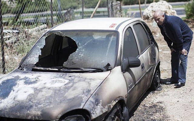 Illustrative photo of a vehicle that was allegedly torched by Israeli settlers in a 'price tag' attack, June 2013. (photo credit: Yonatan Sindel/Flash90)