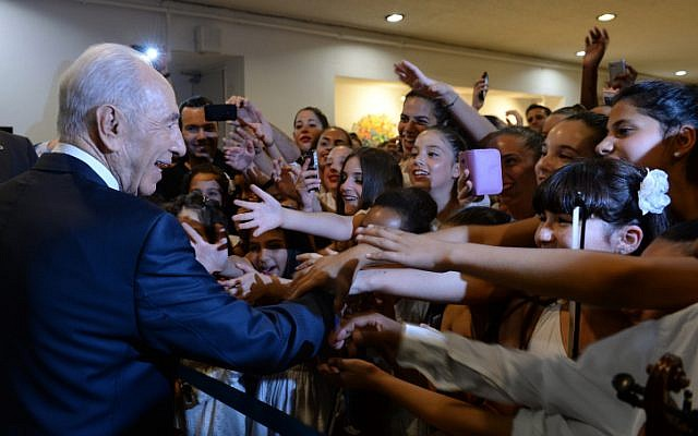 Israelis greet President Shimon Peres a at a celebration event in honor of his 90th birthday, in Jerusalem on Tuesday, June 18 (photo credit: Kobi Gideon/Flash90)
