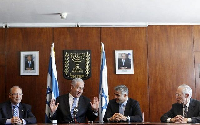 (From left) Jacob Frenkel, Prime Minister Benjamin Netanyahu, Finance Minister Yair Lapid and outgoing Bank of Israel Governor Stanley Fischer at a press conference in the Knesset in Jerusalem, on June 24, 2013. (photo credit: Miriam Alster/Flash90)