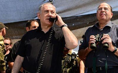 Prime Minister Benjamin Netanyahu and Defense Minister Moshe Ya'alon observe a drill of the Golani Brigade in the Golan Heights, Wednesday, June 26, 2013 (photo credit: Kobi Gideon/GPO/Flash90)